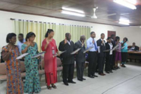 The committee members taking the oath of office
