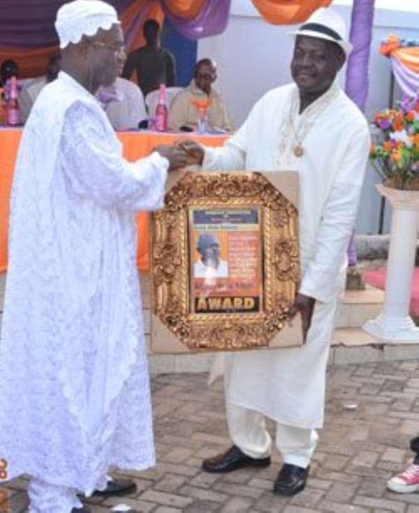 Bechem United president Kingsley Owusu-Achau receiving his award.