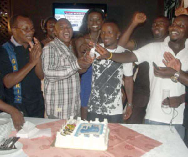 Friends and family join Agbeko to cut the birthday cake