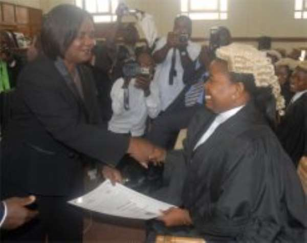 Chief Justice Wood presenting a certificate to Ms Esther Gyamfi, one of the new lawyers