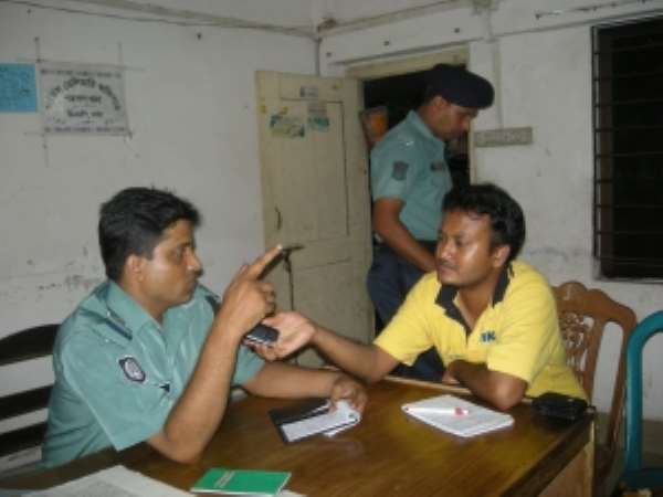 Police officer Wahid being interviewed by the author about the murder of Swopon Mondol. (PhotoDipal Barua)