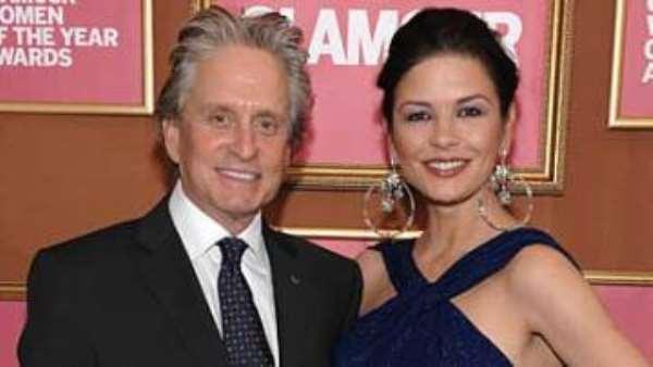 Catherine Zeta Jones with husband Michael Douglas who is battling throat cancer