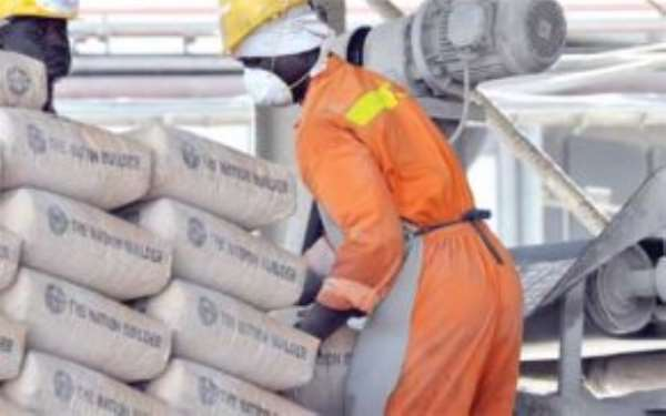 GHACEM workers packing bags at the company's factory in Tema