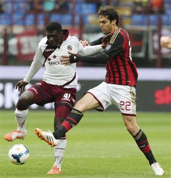 AC Milan Brazilian forward Kaka, right, challenges for the ball with Livorno midfielder Joseph Duncan, of Ghana, during the Serie A soccer match between AC Milan and Livorno at the San Siro stadium in Milan, Italy, Saturday, April 19, 2014.