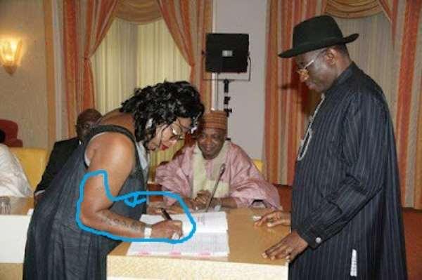 President Jonathan and the tattoo girl.