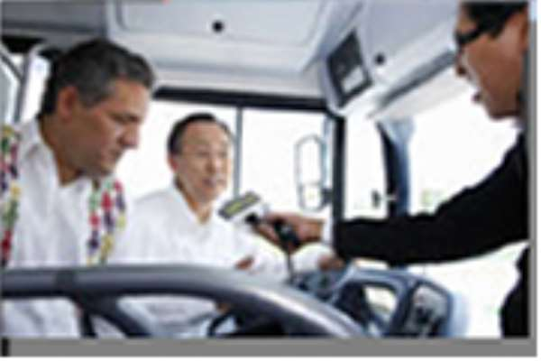 Secretary-General Ban Ki-moon (centre) is interviewed aboard the Chiapas Eco Bus in Cancún, Mexico
