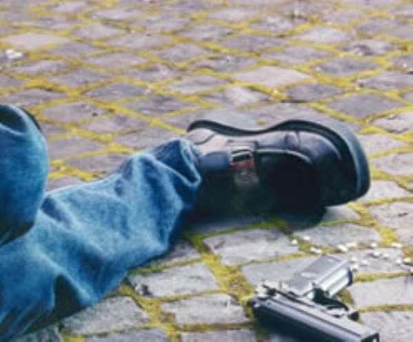 Robber shot dead