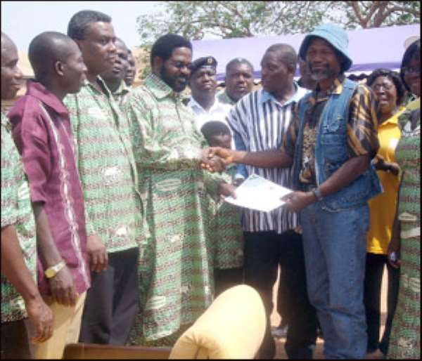 The Accra Metro best farmer receiving his certificate from AMA Boss