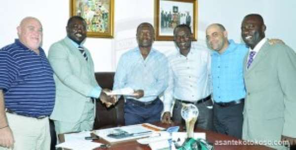 Kotoko and Superbets officials in a pose after the signing ceremony