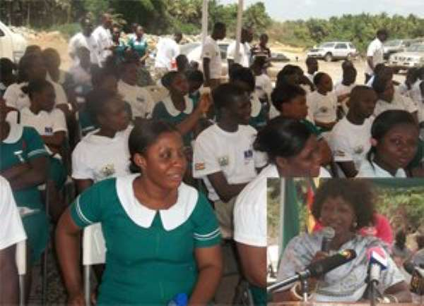 some health workers at the ceremony. INSET: Sherry Ayittey, Minister of Health