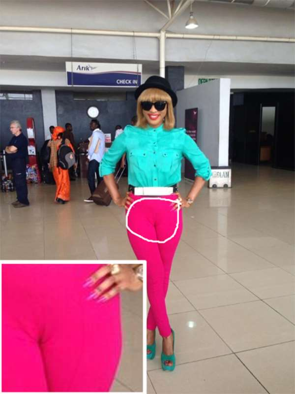 Tonto Dikeh's Airport Pose, You See Color Blocking, But We See...Don't Look If You Are Below 18!