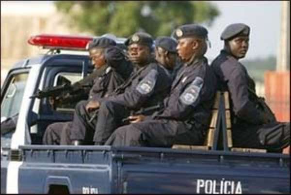 Angolan police escorts the bus carrying Ghana's soccer team