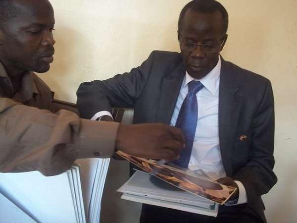 Member of Parliament, Uganda, Alhaj Hussein Kyanjo, reading through Islamic Museum files