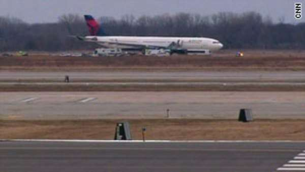 Police met a Northwest Airlines jet in Detroit, Michigan, after reports of a disruptive passenger.