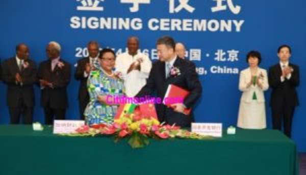 Vice President John Mahama (in white) witnessing the signing of the $3 billion China loan. The signing was done by Ghana's ambassador to China, Mrs. Helen Mamle Kofi and the Vice President of CDB, Mr. Yuan Li