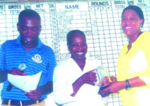 : Mrs. Carol  Boakye, grand daughter of PD Quartey receives her 9-Hole prize from Betty Brown.With them is Obeng Appiah, treasurer of Achimota golf  Club