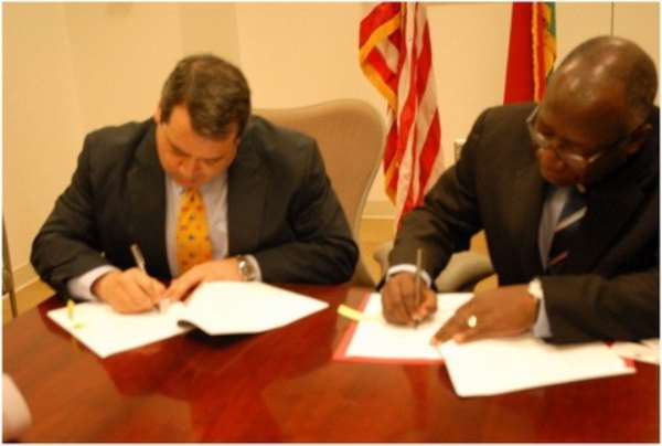 Ambassador Donald Teitelbaum and GCAA Director General Air Commodore (Rtd) Kwame Mamphey signing the grant