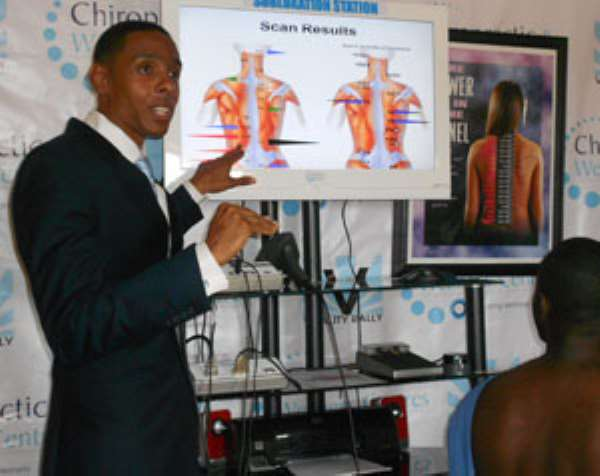 Dr. Marcus A. Manns explaining how the machine works