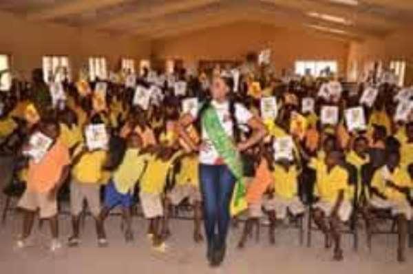 School children in three Northern Regions receive free exercise books