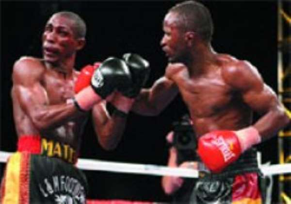 Joseph Agbeko penetrates the guard of Yonnhy Perez (left) on his way to reclaiming his title.