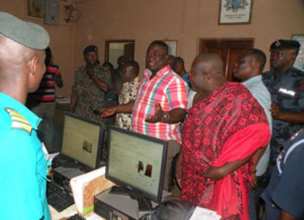 Volta Regional Minister Afotey Agbo interacting with immigration officials