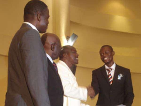 Ahenkan Ebenezer receiving the overall best student award from Alban Bagbin.