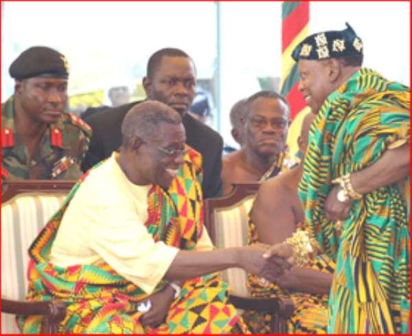 President John Atta Mills in a handshake