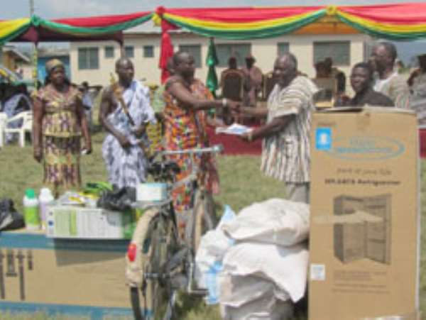 A Member of the Council of State, Mr. Paul Adjei Annan (3rd right) presenting an award to the Overall Best Farmer in the Tema Metropolis for 2010, Nii Narh Abotsi