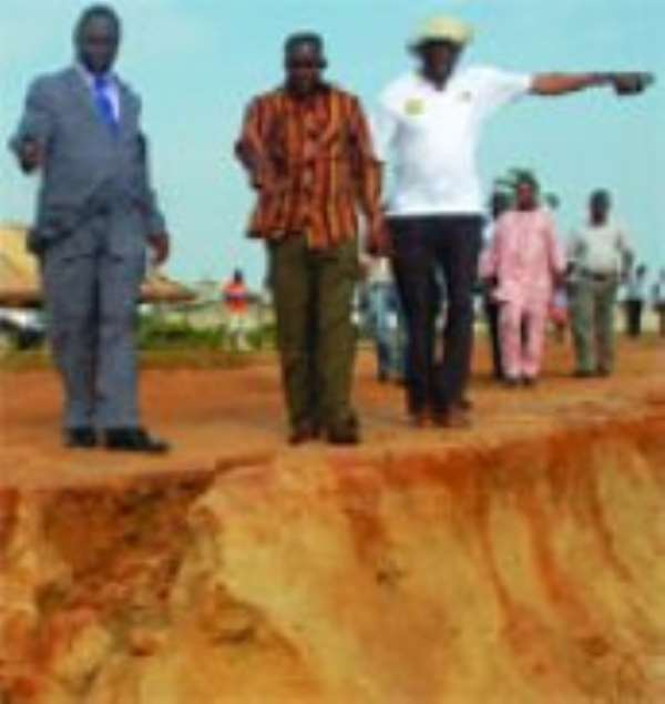 Mr Alban Bagbin (2nd left), Minister of Water Resources,Works and Housing inspecting damage caused by erosion to the coastline.