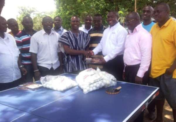 Mawuko Afadzinu (in white shirt) presenting the table tennis board