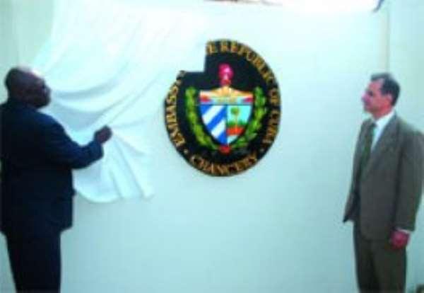 Alhaji Muhammed Mummuni (left), Ghana's Foreign Minister unveiling the logo of the Cuban Embassy. Looking on is Dr Miguel Perez Cruz,  Cuban Ambassador.