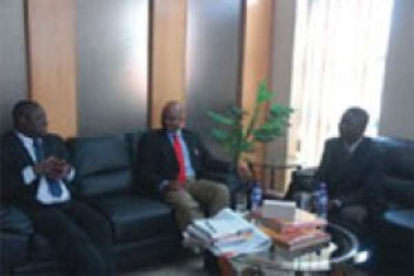 The MD of the Graphic Communications Group Limited ,Mr Ibrahim Awal(left) holding discussions with Mr Kosmas H.Egumbo (second left) during the visit in Accra today.