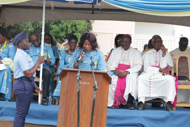 Madam Madam Benedicta Tenni Seidu, the Director of Girls' Education Unit at the Ghana Education Service addressing the audience. Seated Behind are Bishop Anthony Adanuty Founder of School and Bishop Gabriel Kumordji of Keta-Akatsi October 19, 2019. Photo by Damian Avevor