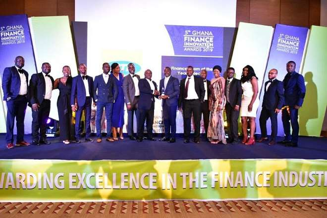 1028201953517-rwnyqdcp53-kobina-bentsi-enchill-senior-manager-corporate-performance-management-receiving-one-of-the-awards-on-behalf-of-mtn