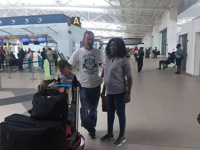 103201874212 ptkwn0y442 madam patience bempong with her husband and son ready to board the fligh.