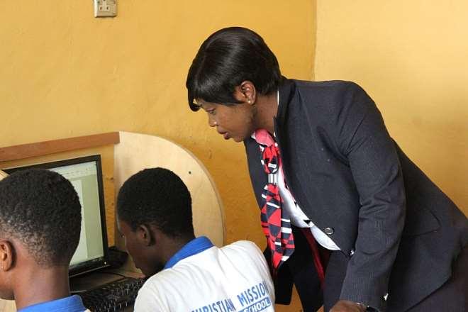 111201874428 l5gsj7v331 british airways staff assists  student on computer