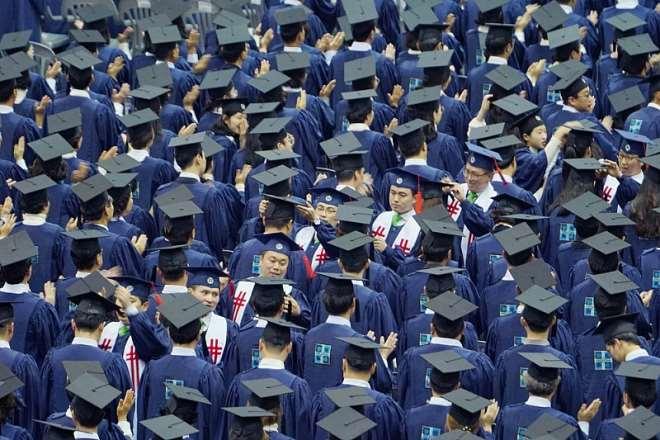 Shincheonji Instructors Are Crossing The Graduation Cap Tassels Of Graduates