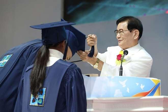 Mr. Man Hee Lee, Chairman Of Shincheonji Church Of Jesus, Is Crossing The Graduation Cap Tassels Of Graduates