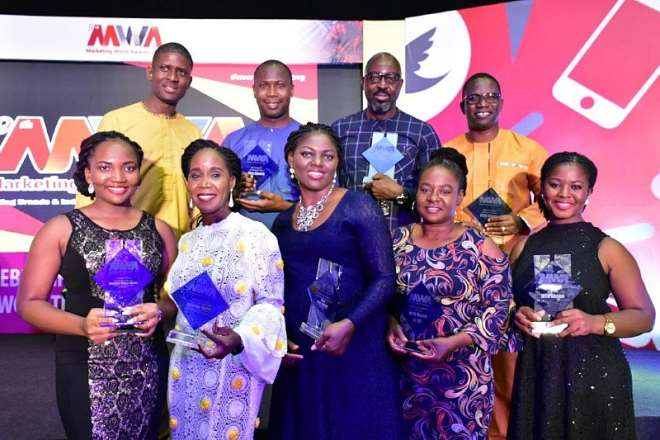 MTN Team displaying the awards