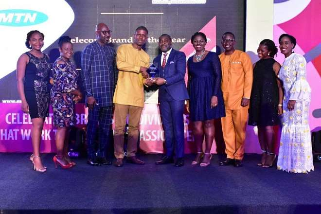 11222019115022-1h830o4aau-germain-naatey-media-planning-manager-receiving-telecom-brand-of-the-year-award-on-behalf-of-mtn
