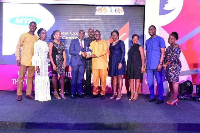 11222019115023-1h830o4aau-lawrence-akosen-senior-manager-customer-planning-and-enablement-receiving-best-company-in-customer-care-award-on-behalf-of-mtn