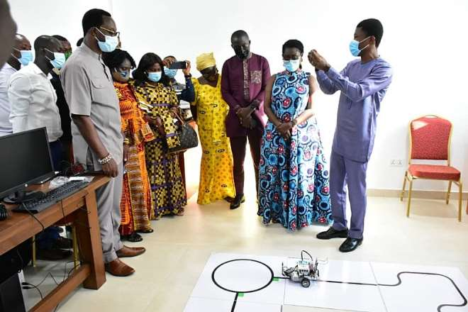 1126202063715-j5fqi7t2gb-a-facilitator-from-the-ghana-robotics-academy-foundation-explaining-to-hon-minister-ceo-of-mtn-and-other-dignitaries-how-they-use-robotics-to-teach-and-develop-solutions