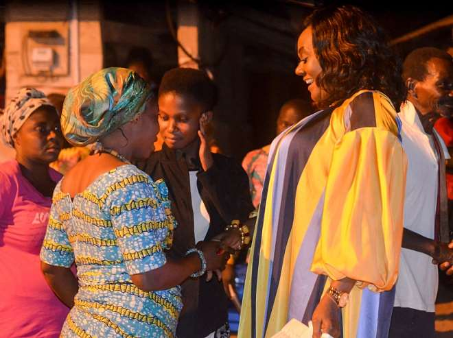 Obaahemaa Nana Ago (left) exchanging pleasantries with the MP (right)