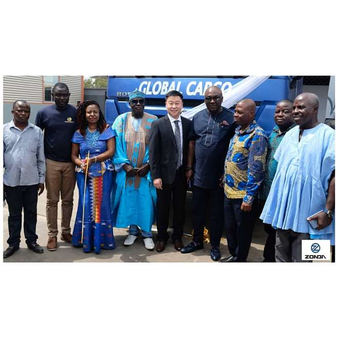 Customers pose with an executive of Zonda Tec Ghana Limited