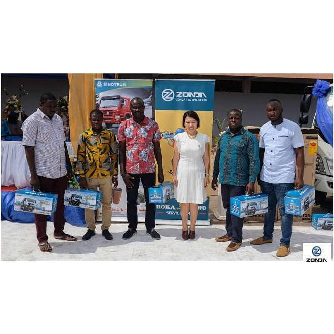 Some loyal customers in a pose with Zonda Ghana CEO, Yang Yang (middle)