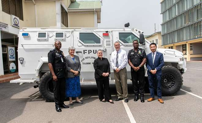U.S. Department of State Assistant Secretary for the Bureau of International Narcotics and Law (INL) Enforcement Affairs Kirsten Madison (middle in black suit) and the U.S. Ambassador to Ghana Stephanie S. Sullivan pictured with (Left to Right) GPS International Relations Directorate Director ACP Baba Saanid Adamu, Police Peacekeeping Deployment and Logistics Subject Matter Expert in Accra Clarence Duncan, Deputy Superintendent (Administration & Pre-Deployment Training FPU) WhoKnows Kwaku Attipoe, and INL Director Jeff Kee.  The group is standing in front of a U.S. donated Armored Personnel Carrier truck that was handed over on April 18, 2018 as a part of the U.S. Government's efforts to enhance capacity of the Ghanaian Police to deploy operational and effective peacekeepers.