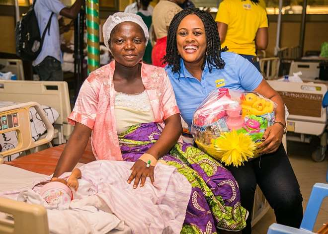 Comms Manager At Mtn Presents Hamper To Beneficiary Mum