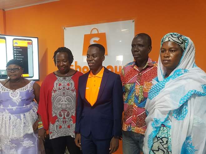 CEO of Shopnaw, Benjamin Osei Asante (middle) and some market union executives in the Greater Accra Region