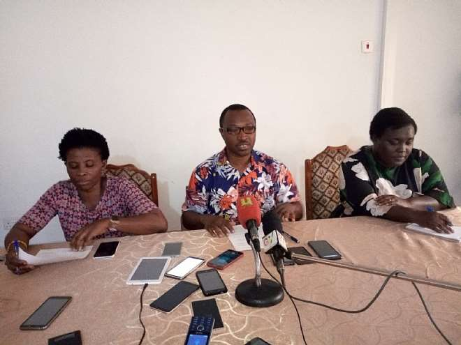 Dr. John Ekow Otoo (middle), the Deputy Director in charge of Public Health for Bono, Bono East and Ahafo Regions addressing the press in Sunyani