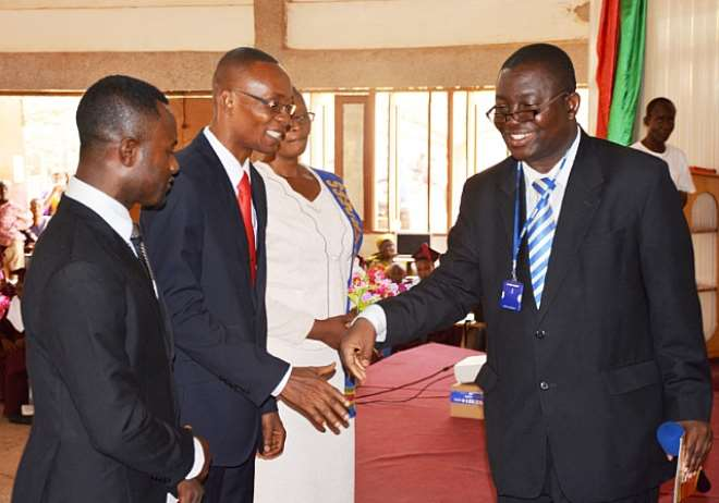 Pastor Kwanin K. Boakye (Right) The President Of The North Ghana Union Mission (NGUM) Of The Seventh-Day Adventist Church Congratulating Pastor George Kossi-Ekao Amouzou (Middle) And Pastor Elisha Nnyira Obeng Bobieh (Left) After An Ordination Service Held At The Weekend In Tamale Pastor Boakye Delivering His Sermon, Charged The Pastors To Preach The Gospel In Advancing The Cause Of The Church To The People Rather Than Engaging In 'Prosperity Theology